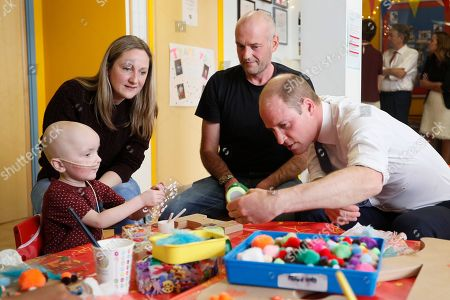 Britain's Prince William meets patient Charlie Miller, 3, with parents Daryl and Sally during a visit to the Royal Marsden hospital in Sutton, England . The Duke of Cambridge, President of the Royal Marsden NHS Foundation Trust, visited the hospital's facilities in Sutton. During the visit, which marks 10 years since His Royal Highness became President of the centre, The Duke accompanied staff as they went about their daily activities in treating and caring for patients