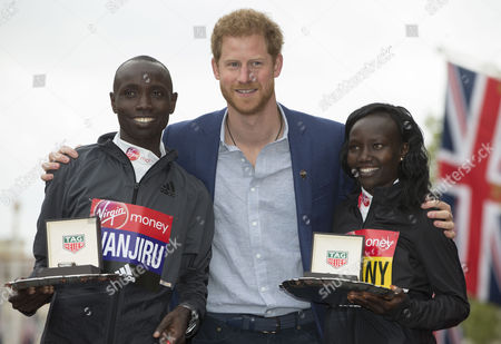 HRH Prince Harry stands with the Men's and Women's Race winners Daniel Wanjiru KEN and Mary Keitany KEN.