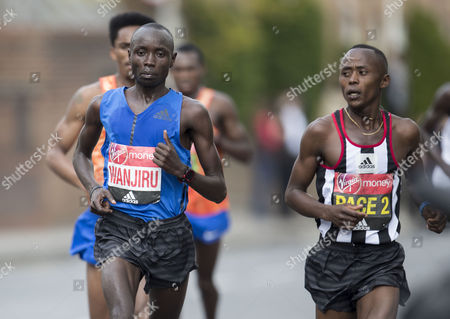Race winner Daniel Wanjiru KEN in-between pace runners.