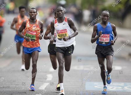 Abel Kirui KEN, Daniel Wanjiru KEN, Bedan Karoki Muchiri KEN during The Men's Race.