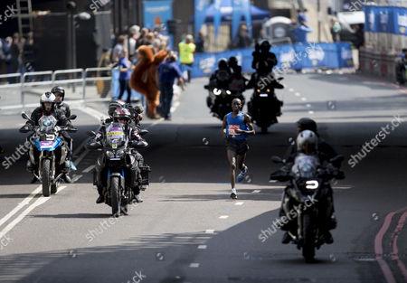 Race winner Daniel Wanjiru KEN.