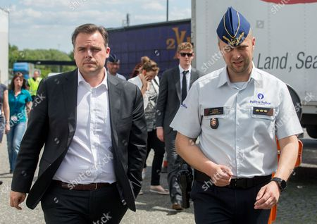 Philippe De Backer, Secretary of State for the Fight against Social Fraud, Protection of Privacy and the North Sea, Deputy Minister for Social Affairs and Public Health (L) chat with a policeman  during a tachograph check  in Brussels, Belgium, 16 May 2017. The Belgian police and experts from Poland, the Netherlands, France, Germany, Denmark and Ireland carry out a checking operation in order to detect the handling of the tachograph used by heavy goods vehicles.