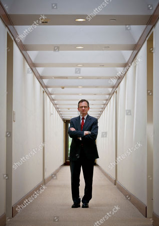 Metropolitan Museum of Art president Dan Weiss poses in a hallway outside his office, in New York