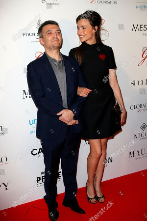 Thomas Langmann and Celine Bosquet-Langmann pose during a photo call for the Global Gift Gala at Four Seasons Hotel George V in Paris, Tuesday, May, 16, 2017