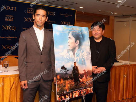 Stock Picture of Japanese actor and member of J Soul Brothers, Naoki Kobayashi, and film director Yoshinari Nishikori pose for photo after they spoke at a press screening of their latest movie 'Tatara Samurai' at the Foreign Correspondents club of Japan in Tokyo.