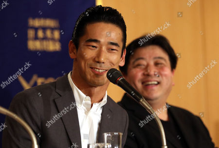 Stock Photo of Japanese actor and member of J Soul Brothers, Naoki Kobayashi, and film director Yoshinari Nishikori speak at a press screening of their latest movie 'Tatara Samurai' at the Foreign Correspondents club of Japan in Tokyo.