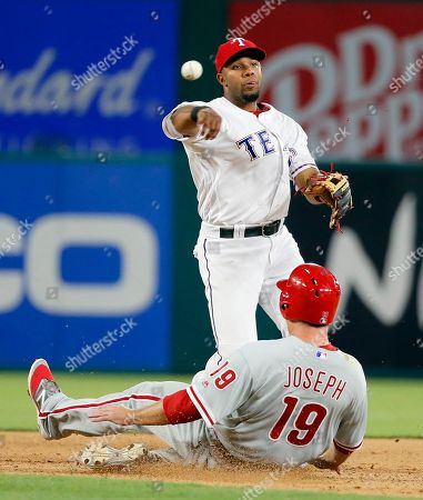 Tommy Joseph, Elvis Andrus Texas Rangers shortstop Elvis Andrus throws to first for the attempted double play after forcing out Philadelphia Phillies' Tommy Joseph (19) in the seventh inning of a baseball game, in Arlington, Texas. The Phillies Michael Saunders was safe at first on a fielders choice