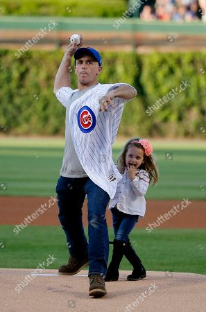 David Eigenberg, Myrna Eigenberg Actor David Eigenberg throws out a ceremonial first pitch with is daughter Myrna by his side before a baseball game between the Chicago Cubs and the Cincinnati Reds, in Chicago