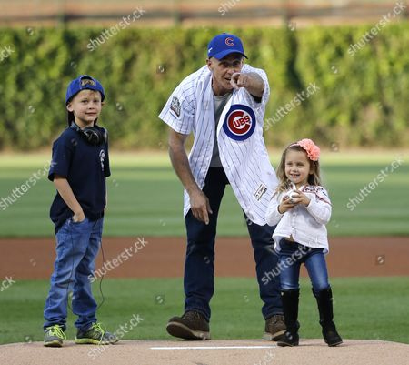 David Eigenberg, Myrna Eigenberg Actor David Eigenberg center, prepares to throw out a ceremonial first pitch with is daughter Myrna, right, and son Louie by his side before a baseball game between the Chicago Cubs and the Cincinnati Reds, in Chicago