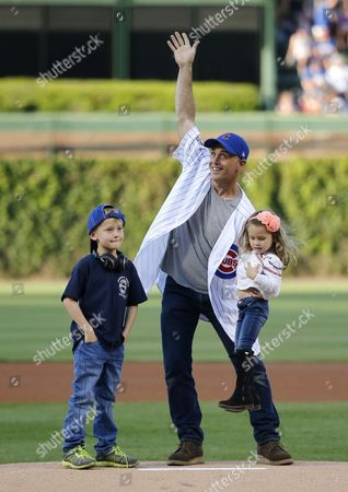 David Eigenberg, Myrna Eigenberg Actor David Eigenberg center, waves to the crowd as he prepares to throw out a ceremonial first pitch with is daughter Myrna, right, and son Louie by his side before a baseball game between the Chicago Cubs and the Cincinnati Reds, in Chicago