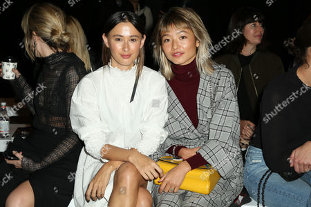 Stock Picture of Eleanor Pendleton and Yan Yan Chan sit front row