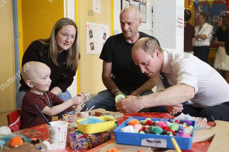 Prince William meets patient Charlie Miller, 3, with parents Daryl and Sally during a visit to the Royal Marsden hospital in Sutton, England Tuesday, May 16, 2017.