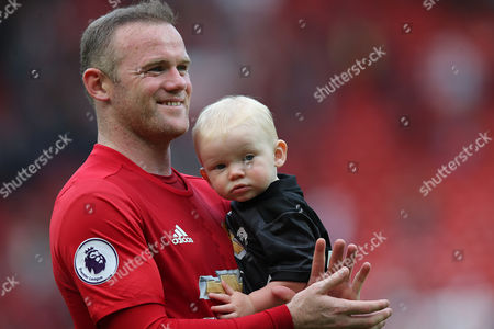 Stock Picture of Uniteds Wayne Rooney HOLDS YOUNGEST SON Kit Rooney