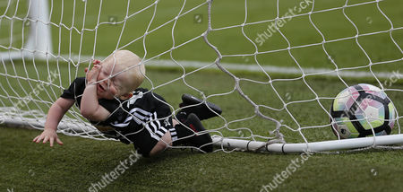 Kit Rooney FALLS INTO THE NET TRYING TO RETRIEVE THE BALL