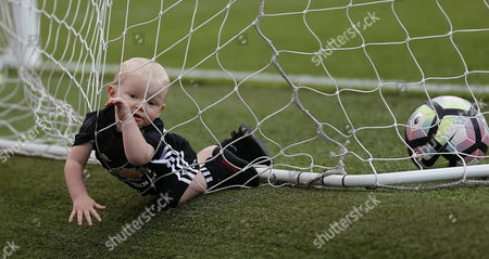 Stock Photo of Kit Rooney FALLS INTO THE NET TRYING TO RETRIEVE THE BALL