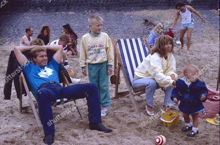 Coronation Street trip to Blackpool. Christopher Quinten (as Brian Tilsley), Warren Jackson (as Nicky Tilsley), Helen Worth (as Gail Tilsley) and Lynsay King (as Sarah Platt)