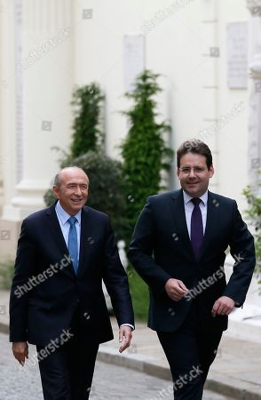 Newly named French Interior Minister Gerard Collomb, left, walks with outgoing Interior Minister Matthias Fekl during the handover ceremony in Paris, Wednesday May, 17, 2017 in Paris. Collomb has been a prominent Socialist politician in France since becoming mayor of Lyon in 2001 _ France's third biggest city
