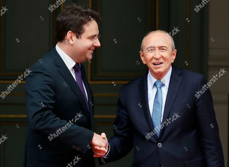 Newly named French Interior Minister Gerard Collomb, right, shakes hands with outgoing Interior Minister Matthias Fekl during the handover ceremony in Paris, Wednesday May, 17, 2017 in Paris. Collomb has been a prominent Socialist politician in France since becoming mayor of Lyon in 2001 _ France's third biggest city