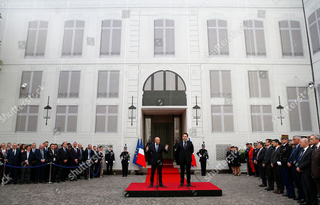 Newly named French Interior Minister Gerard Collomb, left, speaks while outgoing Interior Minister Matthias Fekl listens during the handover ceremony in Paris, Wednesday May, 17, 2017 in Paris. Collomb has been a prominent Socialist politician in France since becoming mayor of Lyon in 2001, France's third biggest city