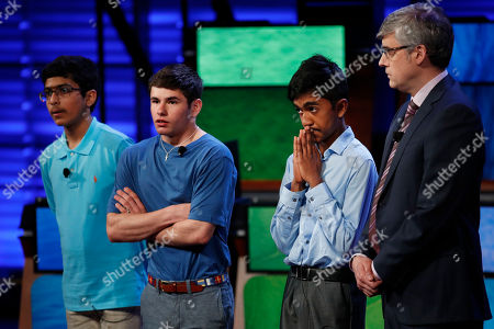 Veda Bhattaram, Thomas Wright, Pranay Varada, Mo Rocca Host Mo Rocca watches at right as, from left, Veda Bhattaram, 13, of Montville, N.J., Thomas Wright, 14, of Milwaukee, Wis., and Pranay Varada, 14, of Carrollton, Texas, nervously wait to hear who has made it into the top two at the 2017 National Geographic Bee, at the National Geographic Society in Washington. Bhattaram came in third, Wright second, with Varada winning the bee