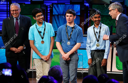 Veda Bhattaram, Thomas Wright, Pranay Varada, Mo Rocca, Gary Knell President Gary Knell, left, and host Mo Rocca, right, congratulates the winner of the 2017 National Geographic Bee, from second from left, third place winner Veda Bhattaram, 13, of Montville, N.J., second place winner Thomas Wright, 14, of Milwaukee, Wis., and first place winner Pranay Varada, 14, of Carrollton, Texas, at the National Geographic Society in Washington