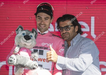 Dutch rider Tom Dumoulin of Sunweb Team, celebrates on the podium with former Italian Alpine Skier Alberto Tomba (R) after retaining the overall leader's pink jersey following the 11th stage of the 100th Giro d'Italia cycling race,  over 161 km from Florence to Bagno di Romagna, Italy, 17 May 2017.