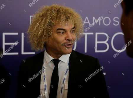 "Former Colombian soccer star Carlos Valderrama talks to journalists upon his arrival to the symposium, ""Let's discuss soccer"" at the Conmebol Museum Hall in Luque, Paraguay"