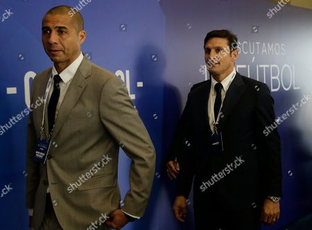 """Javier Zanetti, David Trezeguet Argentine soccer stars David Trezeguet, left, and Javier Zanetti, arrive to the symposium, """"Let's discuss soccer"""" at the Conmebol Museum Hall in Luque, Paraguay"""