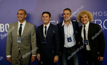 "Javier Zanetti, David Trezeguet, Gabriel Batistuta, Carlos Valderrama Argentine soccer stars from left, David Trezeguet, Javier Zanetti, Gabriel Batistuta, and Colombian soccer star Carlos Valderrama, pose for a group photo upon their arrival to the symposium, ""Let's discuss soccer"",at the Conmebol Museum Hall in Luque, Paraguay"