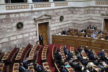 The seats of ultra right Golden Dawn's parliamentary group (L) are seen empty during a session in the Greek Parliament in Athens, Greece, 17 May 2017. The parliament plenary decided to expel Golden Dawn's parliamentary group from the parliamentary debates on the omnibus bill which will conclude on 18 May.The decision was unaminous, the president of the parliament Nikos Voutsis said. On 15 May, Golden Dawn's lawmaker Ilias Kasidiaris pushed and verbally attacked New Democracy MP Nikos Dendias during a debate in parliament. Golden Dawn will be considered as absent and have no voting right on the bill.