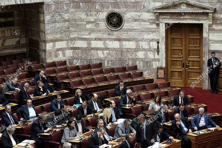 The seats of ultra right Golden Dawn's parliamentary group (back) are seen empty during a session in the Greek Parliament in Athens, Greece, 17 May 2017. The parliament plenary decided to expel Golden Dawn's parliamentary group from the parliamentary debates on the omnibus bill which will conclude on 18 May.The decision was unaminous, the president of the parliament Nikos Voutsis said. On 15 May, Golden Dawn's lawmaker Ilias Kasidiaris pushed and verbally attacked New Democracy MP Nikos Dendias during a debate in parliament. Golden Dawn will be considered as absent and have no voting right on the bill.
