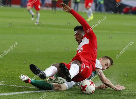 Stock Image of Ze Luis  (top) of FC Spartak Moscow fights for a ball with Andrei Semyonov of Terek Grozny during the Russian Premier League match between FC Spartak Moscow and Terek Grozny at Otkrytie Arena Stadium in Moscow, Russia, 17 May 2017. Spartak Moscow have won their first Russian Premier League title since 2001.