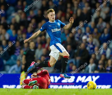 Aidan Wilson of Rangers jumps over a challenge from Kenny McLean of Aberdeen during the SPFL Ladbrokes Premiership match between Rangers & Aberdeen played at Ibrox Stadium, Glasgow on 17th May