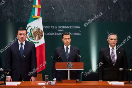 """Miguel Angel Osorio Chong, Enrique Pena Nieto, Miguel Angel Mancera Mexico's President Enrique Pena Nieto, center, stands for a moment of silence for murdered journalists, flanked by Interior Minister Miguel Angel Osorio Chong, left, and Miguel Angel Mancera, Mexico City mayor and head of Mexico's association of state governors, during an event to promote action to protect journalists and human rights defenders, in Mexico City, . During the moment of silence, some journalists covering the event shouted out """"Justice!"""" Pena said he is taking actions to halt slayings of journalists and promised more resources to help those under threat"""