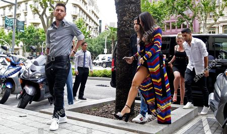 Luis Suarez, Cesc Fabregas, Daniella Semaan, Sofia Balbi FC Barcelona's Lionel Messi, left, Cesc Fabregas, center, and his wife Daniella Semaan, FC Barcelona's Luis Suarez, background right, and his wife Sofia Balbi arrive for a commercial event in Barcelona, Spain