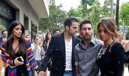 Cesc Fabregas, Daniella Semaan, Lionel Messi FC Barcelona's Lionel Messi, second right, and his girlfriend Antonella Roccuzzo, right, arrive for a commercial event next to Cesc Fabregas, center, and his girlfriend Daniella Semaan, left, in Barcelona, Spain