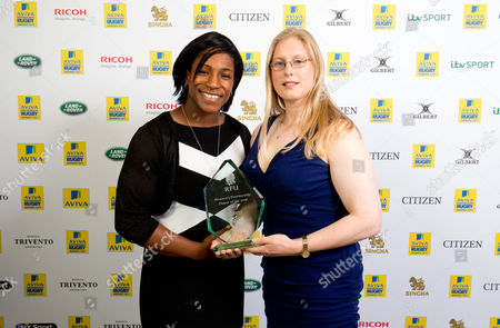 Becky Williams, (R) director of rugby of Lichfield RFC receives the Women's Premiership Players' Player of the Year on behalf of Harriet Millar-Mills of Lichfield from former England international Maggie Alphonsi (L)