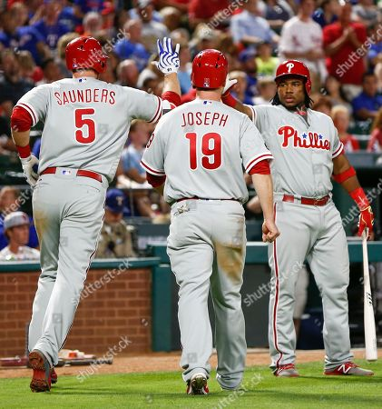 Michael Saunders, Maikel Franco, Tommy Joseph Philadelphia Phillies' Michael Saunders (5) celebrates his two-run home run with Maikel Franco, right, against the Texas Rangers during the seventh inning of a baseball game, in Arlington, Texas. Tommy Joseph, center, scored on the homer