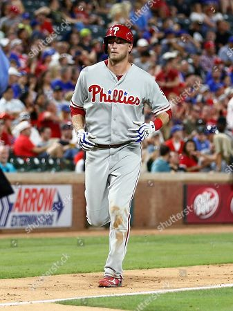 Philadelphia Phillies' Michael Saunders runs in to score on his two-run home run against the Texas Rangers during the seventh inning of a baseball game, in Arlington, Texas