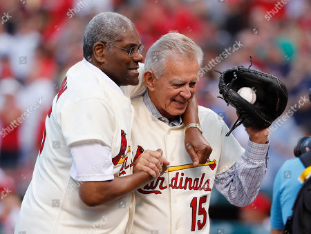 Bob Gibson, left, and Tim McCarver, members of the St. Louis Cardinals' 1967 World Series championship team, takes part in a ceremony honoring the 50th anniversary of the victory before the start of a baseball game between the St. Louis Cardinals and the Boston Red Sox, in St. Louis