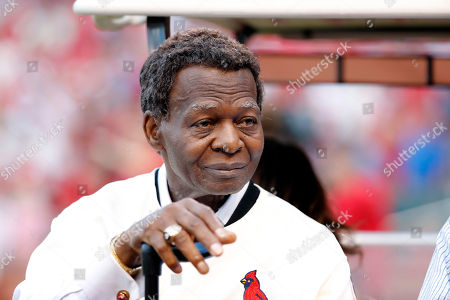 Lou Brock, a member of the St. Louis Cardinals' 1967 World Series championship team, takes part in a ceremony honoring the 50th anniversary of the victory before the start of a baseball game between the St. Louis Cardinals and the Boston Red Sox, in St. Louis