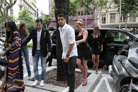 Daniella Semaan, Cesc Fabregas, Luis Suarez and Sofia Balbi attend the opening of a new Sarkany shoes store in Barcelona.