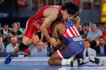 "Sohsuke Takatani, Jordan Burroughs Japan's Sohsuke Takatani, left, and the United States' Jordan Burroughs face off during the East Meets West ""Beat the Streets"" wrestling event in Times Square, in New York"