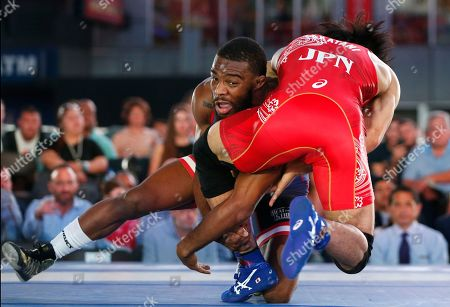 """Sohsuke Takatani, Jordan Burroughs United States' Jordan Burroughs, left, and Japan's Sohsuke Takatani compete during the East Meets West """"Beat the Streets"""" wrestling matches, in New York's Times Square"""