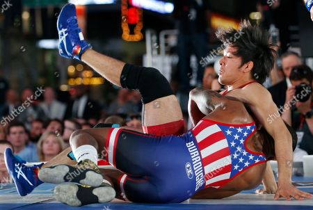 """Sohsuke Takatani, Jordan Burroughs Japan's Sohsuke Takatani and Jordan Burroughs of Lincoln, Neb., compete during the East Meets West """"Beat the Streets"""" wrestling event, in New York's Times Square"""