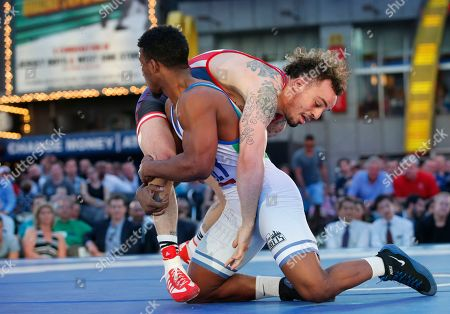"""Jordan Oliver, Frank Chamizo USA's Jordan Oliver battles Italy's Frank Chamizo during the East Meets West """"Beat the Streets"""" wrestling competition featuring former Olympians vs. Japanese competitors to benefit wrestling programs for New York City student- athletes in Times Square, in New York"""