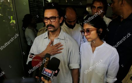 Aamir Khan, Kiran Rao Bollywood actor Aamir Khan left along with his wife Kiran Rao speaks with media after paying respect to actress Reema Lagoo during her funeral in Mumbai, India, . Lagoo, the ever-smiling screen mother to some of India's top actors, died Thursday. She was 59