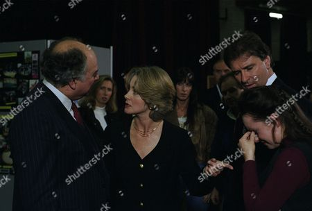 Stock Picture of Tina causes a scene at the parents evening claiming that Bernard touched her. The Head takes Tina's side and Angharad slaps him calling him a sanctimonious hypocrite - With Angharad McAllister, as played by Amanda Wenban ; Bernard McAllister, as played by Brendan Price ; Headmaster, as played by Norman Mills, and Tina Dingle, as played by Jacqueline Pirie. (Ep 1940 - 19th January 1995).