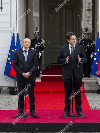Stock Photo of Outgoing French Interior Minister Matthias Fekl (R) makes a speech with his successor Gerard Collomb during an official handover ceremony