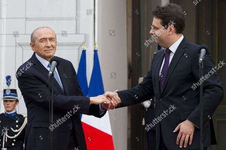 Outgoing French Interior Minister Matthias Fekl (R) makes a speech with his successor Gerard Collomb during an official handover ceremony